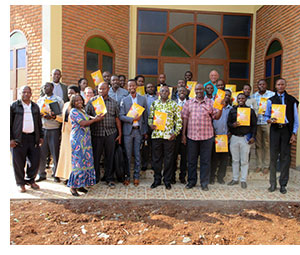 Leadership seminar attendees with their leadership books.