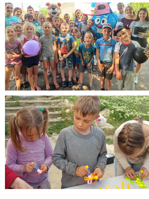 Children at a Christian camp and Kostya doing crafts.