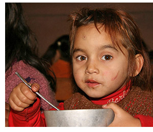 Roma child at the soup kitchen.