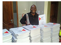 Pastor Arthur with 500 copies of The Essentials of Excellent Christian Leadership