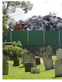 Scrap metal at the end of a church graveyard.