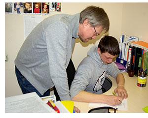 Andrey helping a boy.