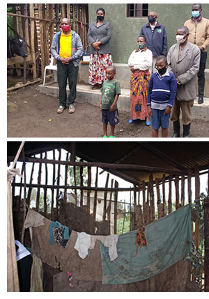 A family standing in front of their new house and another house in very poor condition