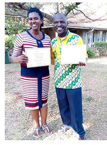 Christine and Francois with their course certificates